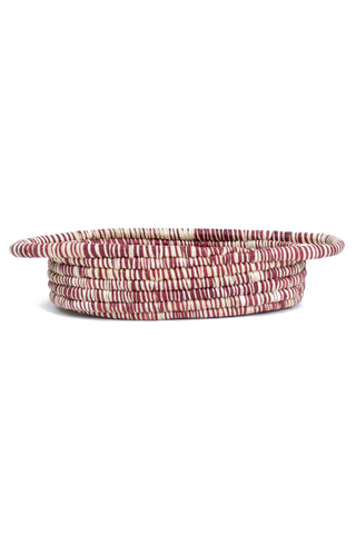 Heathered Berry Oval Baket by All Across Africa. Handwoven in Uganda. Intricately crafted with timeless tradition, this carefully dyed raffia fiber and sweet grass basket makes a stunning statement piece. Color red and white. 100% raffia.