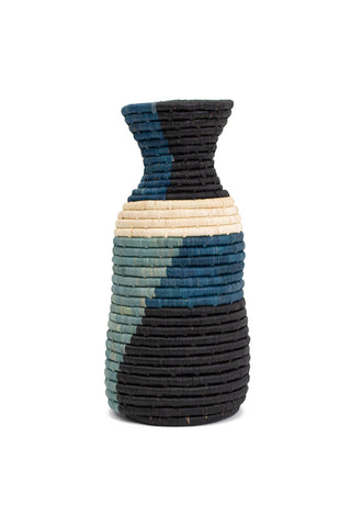 Blue Night Color Blocked Vase by All Across Africa. Handwoven in Uganda. Intricately crafted with timeless tradition, this carefully dyed raffia fiber and sweet grass vase makes a stunning statement piece. Color Blue. 100% raffia.