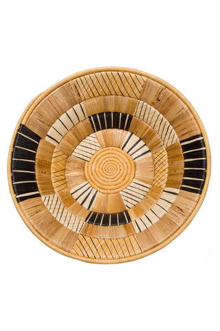 Banana Bark and Raffia Sunrise Bowl by All Across Africa. Intricately woven.  Craftswomen in Rwanda use timeless tradition to weave carefully dyed sisal fibers and sweet grass to make stunning one of a kind pieces rich in cultural meaning and purpose.  They are just the right size for a center piece or fruit bowl.