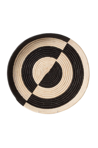 Mwezi Raffia Tray by All Across Africa. Handwoven in Uganda. Intricately crafted with timeless tradition, these carefully dyed raffia fiber and sweet grass trays make a stunning statement piece. Color black and white. 100% raffia.