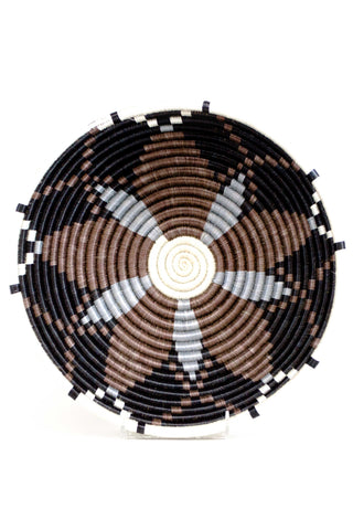 "Large Black and Chocolate Hope Basket from All Across Africa. Craftswomen in Rwanda weave carefully dyed sisal fibers and sweet grass to make stunning one of a kind pieces rich in cultural meaning and purpose.  They are just the right size for a center piece, fruit bowl, or wall hanging. The sunburst pattern on these baskets is known as the ""hope"" design. Reflected on the Rwandan flag, this sunburst image stands for the country's collective hope for a new dawn and brighter future."