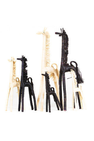 Wrapped Raffia Giraffes from All Across Africa. Available in Black and Natural. This specially designed and crafted giraffe is an organically unique creation that has fun and traditional qualities. Made in Uganda from earthy and soft banana bark and naturally dyed raffia, this decorative piece is exemplary of how a handmade product brings richness and distinctness to your home decor. Meaningfully and purposefully designed.