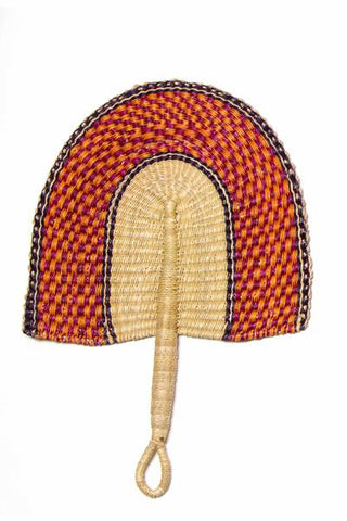 "Ghanaian Fan from All Across Africa. This stunning fan is hand-made in Bolgatanga, Ghana out of Elephant Straw and organic dyes. Perfect on a hot-summer day or as unique wall décor, hang on a wall next to your favorite artwork to give your space a traveled look. Approximately 17"" L x 11"" W x 1"" H Made of natural fibers and grass; do not submerge in water. If necessary, use a damp cloth to wipe clean. Available in Lime Fuchsia and Navy."
