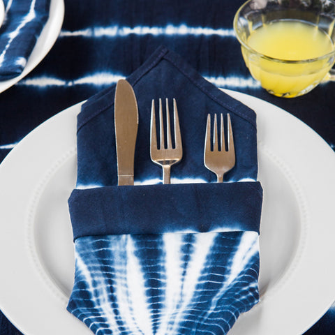 Shibori Napkin Set by Matr Boomie. Handmade in India. Set assortment of 100% cotton napkins with 4 unique shibori designs. Color blue and white. 100% cotton.