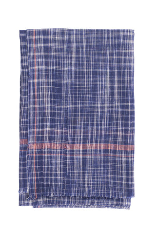 Indigo Khadi Bath Towel by Anhad Craft. Handwoven in India. Handwoven cotton khadi towel featuring contrast pink stripe and fringed edge details. Color blue. 100% cotton khadi.