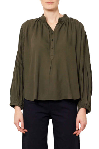 Apiece Apart Fall 2018 Bravo Pintuck Blouse in Military. Mandarin collar blouse with front button placket. Exaggerated poet sleeves with pintuck detail. Button-front with a stand collar. Features blouson sleeves with delicate pintucking and a loose, airy fit that's so easy and comfortable. Button fastenings at front. Loose fit. Made in India. Color olive green. 100% rayon. Sizes 0 2 4 6.