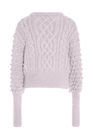 Apiece Apart Fall 2018 Lieve Handknit Cable Crewneck Sweater in Lavender. Features a round neckline, contrast knit sleeves, and exaggerated sleeve cuffs. Drop shoulder pull on sweater. Wide waist band. Unlined. Hand knit in Peru. Fits true to size. Color purple. 50% alpaca, 45% acrylic, 5% wool. Sizes x-small small medium.