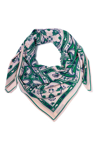"A Peace Treaty Fall 2018 Innis Scarf in Green. Printed square silk scarf featuring a 70's inspired paisley bandana print in light pink, green, and midnight blue. Rolled edge sewn hem. Hand printed in India. 45"" by 45"". Color green pink blue. 100% silk crepe. One size."