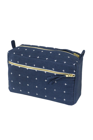 Small Navy Toiletry Bag by Anchal Project. Handmade in India. Keep everything in one place in the small toiletry bag, no matter where you are traveling. The compact size keeps all your essentials in one place and is easy to pack in your overnight bag or suitcase. Color Navy. 100% organic cotton canvas.