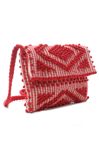 Antonello Suni Rombi Clutch in Red. Cross Body bag is made using hand woven regenerated 100% cotton with a beautiful cotton lining and a practical inner pocket in a diamond pattern. Braided cotton shoulder strap. Magnetic closure. Dustbag included. The bag is made using authentic Sardinian hand weaving methods in ethically managed factories. Measures 8 inches by 11 inches. 18 inch strap drop. Color red white. 100% cotton. One size.