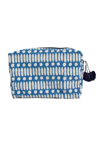 Dot Dash Block Print Washbag from Bohemia Design. This hand block printed wash bag features a bold contrast dot-dash print and waterproof lining. Made entirely by hand from block printed natural cotton canvas and decorated with a wool pom pom zip tassel.