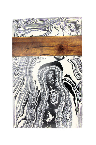 Zebra Marble Board by Be Home. Handcrafted in India. Designed in Northern California, the Zebra Marble Board is handcrafted by master artisans in India from white marble, resin composites, and mango wood accents. 100% food safe. Color blue and white.
