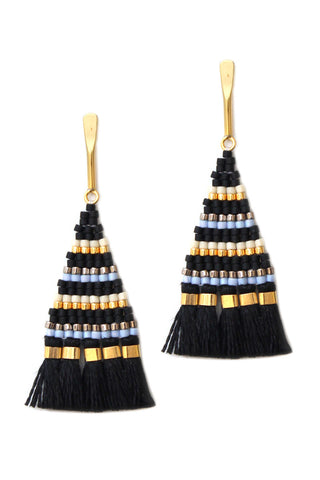 Bluma Project Spring 2018 Sadie Earring in Black. Petite beaded triangle statement earring with fringe detail. Beaded dangle earring with a tassel fringe on a delicate gold-washed post. Post fastening for pierced ears. Made by artisans in Guatemala. 2.25 inch drop. Color black gold. Glass and 24k gold beads, linen, gold plated brass. One size.