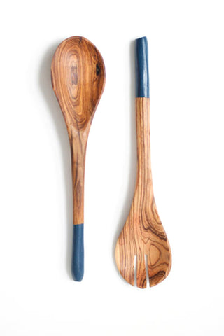 Olive Wood Kuni Utensil Set from Badala. Available in Faded Navy Black Gunmetal and Nude. Beautifully functional, this handmade utensil set was crafted from locally sourced olive wood then accented with a pop of color. Serve up any meal in style, whether you are entertaining or just enjoying some you time over a delicious plate of pasta.