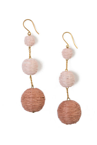 Chan Luu 3 Tier Raffia Pom Pom Earring in Café. Wrapped raffia pom pom statement drop earring. Ombre tonal raffia in white nude pink. Fishhook fastening for pierced ears. 2 inch drop. Color nude tan mauve. One size.