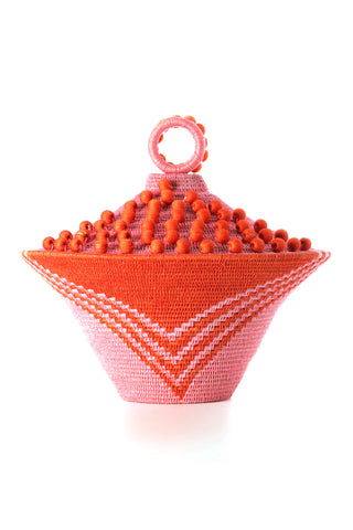 Peony Lidded Basket Urn by Charlie Sprout. Handmade in Swaziland, these unique and bold decorative accents support female artisans and are bold additions to any room. Swazi baskets are the most labor intensive of all the African baskets, taking between 30-80 hours to make each piece.