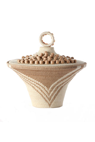 Cream Lidded Basket Urn by Charlie Sprout. Handmade in Swaziland, these unique and bold decorative accents support female artisans and are bold additions to any room. Swazi baskets are the most labor intensive of all the African baskets, taking between 30-80 hours to make each piece.
