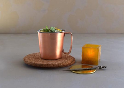 Hearty Mule Mug by Coppre. Handcrafted in India. The Mule Mug is a tribute to the Moscow Mule, a cocktail with a kick that demands its own copper mug. Copper outer, finished with food safe lacquer. Stainless steel inner. Color copper.