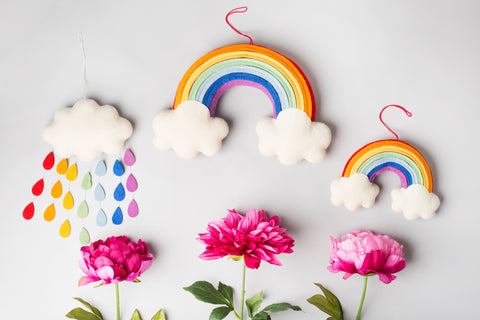 Rainbow Drop Cloud by Craftspring. Handmade in Kyrgyzstan. A wall hanging that is not only beautiful in its design but lightweight and unbreakable. The perfect decoration for kids rooms and a great baby shower gift. All details and stitching are hand-embroidered. Color multi. 100% wool.