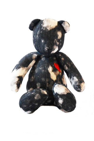 Mayi Mascot from Diego Binetti. Handmade denim mascot by Binetti Home with bleached detailing and embroidered heart. This giant teddybear makes the perfect ethically-crafted gift. Black and White Denim. Measurments Height Sitting Position: 13.5""