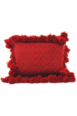 Chachal Brocade Mini Pillow by Del Palomar. Handmade in Guatemala. Handwoven authentic Guatemalan fabric pillow, featuring an intricately woven brocade pattern and delicate pom pom fringe border. Handwoven on a traditional footloom by local artisans in Chimaltenango, Guatemala. Color red. 100% cotton.
