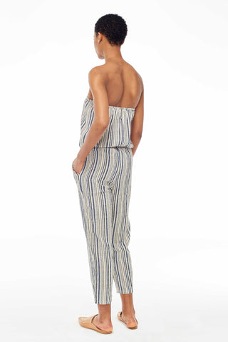Elina Lebessi Spring 2018 Strapless Jumpsuit in Mykonos. Strapless woven jumpsuit with elastic at waist. Ankle crop leg with raw-hem pockets at hip. Small measures 45 inches from bust to hem. Color Light Blue Off-White. Sizes Small Medium Large.