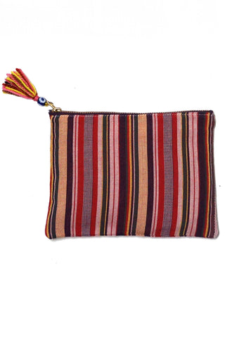 Elina Lebessi Multi Stripe Pochette in Red. Multicolor red stripe woven pattern; zip closure with small tassel. Handcrafted by artisans in rural areas in a small workshop outside of Crete. Waterproof interior lining making it the perfect travel accessory for packing toiletries or swimsuits. Small measures 5.5 inches by 8.5 inches. Large measures  8.5 inches by 11 inches. Color red blue green natural.. Sizes Small Large.