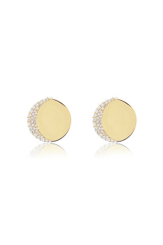 Edge of Ember Spring 2018 Moon Disc Stud Earrings in Gold. Statement stud disc post earrings with white topaz encrusted crescent moon design. Post fastening for pierced ears. Ethically made in India. 0.5 inch diameter. Color gold. 18K gold plated sterling silver, white topaz. One size.