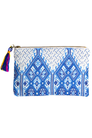 Elina Lebessi Plaka Pochette in Light Blue. Blue and white woven pattern; zip closure with small tassel. Handcrafted by artisans in rural areas in a small workshop outside of Crete. Waterproof interior lining making it the perfect travel accessory for packing toiletries or swimsuits. Small measures 5.5 inches by 8.5 inches. Large measures  8.5 inches by 11 inches. Color blue white. Sizes Small Large.