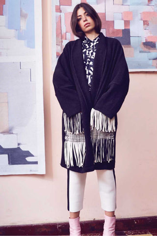 Escudo Fall 2018 Colby Jacket. Oversized sweater coat with handwoven fringe pocket detail in black and white. Features open front and fold over lapel collar. Color black. 100% Cotton. One size.