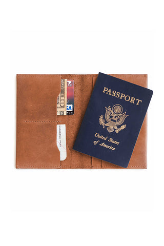 "Eyerusalem Passport Wallet in Cognac by ABLE. Soft, rich hand crafted leather wallet holds a passport and has 4 slots for credit cards, money and travel documents. 100% Ethiopian leather. Measurements 4"" x 6"" (when closed)"
