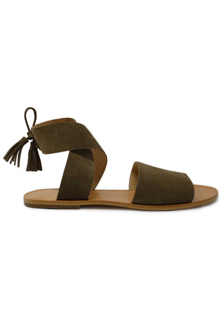 ABLE Spring 2018 Cruz Utility Sandal in Olive. Flat open toe lace up sandal with wrap around ankle strap and tassel tie at ankle. Made with a leather sole and suede upper that mold to your feet for ultimate comfort. Handmade in Peru. Color olive green. Suede upper. Leather insole. Sizes 6 7 8 9 10.