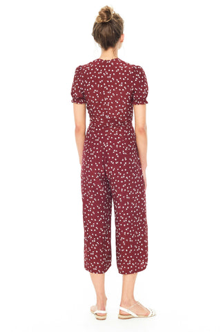 Faithfull Resort 2018 Bonnie Jumpsuit in Berry Betina Floral Print. Flare leg ankle length jumpsuit Faithfull's Berry Betina Floral print. Features deep-V neckline and self-tie belt at waist. Hidden zipper at back. Color red burgundy. 100% Rayon Crepe. Sizes x-small small medium large.