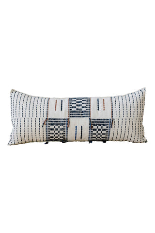 Adjoukrou Lumbar Pillow by Five Six Textiles. Handwoven in Côte d'Ivoire. The intricate Adjoukrou motif is modeled on the traditional pattern of the Adioukrou people of Côte d'Ivoire. Bold motifs mixed with muted colors make this lumbar pillow the perfect statement on any couch or bed. Color multi. 100% raw cotton.