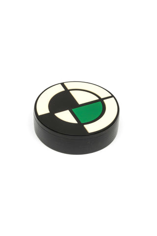 Metropolis Round Box by Finn. Handcrafted in Argentina. Round box in 3D acrylic art deco design. The Metropolis collection is inspired by the art-deco movement and the works of Francisco Salomone Italian-Argentine architect who introduced modern architecture in the province of Buenos Aires. Color black white green. 100% acrylic.