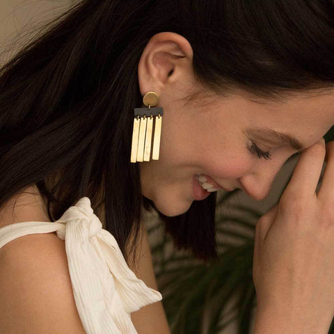 Soko Spring 2018 Cala Horn Fringe Stud Earring. Round post with carved horn and brass fringe detail. Post fastening for pierced ears. Handcrafted in Kenya using traditional artisan techniques. 2 inch drop. Color gold black. Recycled polished brass. Hand carved horn. One size.