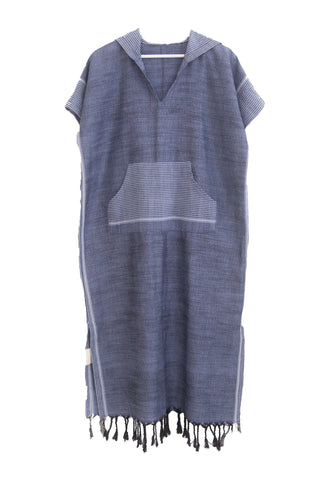 Mykonos Maxi Caftan by Home & Loft. Handwoven in Turkey. Handwoven maxi caftan in cool indigo, featuring short sleeves, front pouch pocket, striped side seam panels and bottom fringe detail. Color navy. 100% cotton.