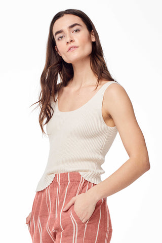 Hesperios Spring 2018 Lou Ribbed Knit Tank Top in Creme. Ultra soft ribbed knit fitted sleeveless cropped tank. Plunging V neckline can be worn in front or back. Slightly cropped cut. Ribbed hem. Small measures 20 inches from shoulder to hem. Color cream beige. 80% baby alpaca 20% silk. Sizes X-Small Small Medium Large.