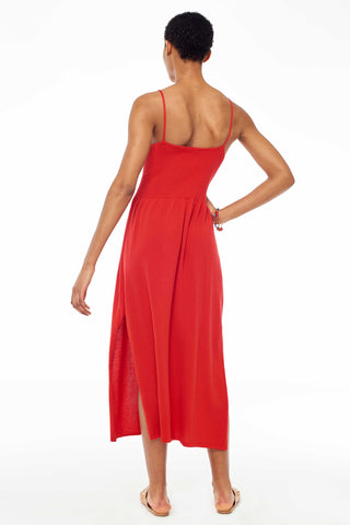 Hesperios Spring 2018 Gayle Dress. Summer strappy knit dress with ribbed bodice. Thin straps. Square neckline. Ribbed bodice. Fine gauge rib knit skirt with short side slits. Unlined. Fitted top with a relaxed bottom fit. Color red. Small measures 41.75 inches from shoulder to hem. 100% Pima cotton. Sizes X-Small Small Medium.