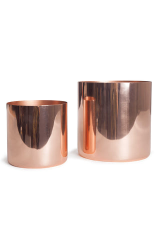 "The Louise Cachepots by Hawkins NY let you dress up your house plants. Made of plated steel, copper finish, and in two sizes, allow a quick and easy option to highlight your favorite plant or floral arrangement. MeasurementsS: 6 x 6"" L: 8 x 8"""