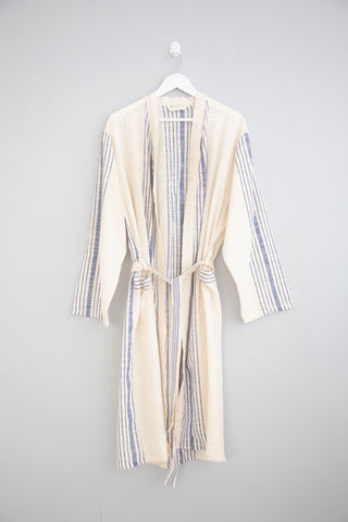 Hudson Robe by Home & Loft. Handwoven in Turkey. Lightweight and airy, the Hudson Robe will soon become your go-to for all things around the house. Handwoven by master artisans in Turkey, this robe features two front patch pockets and a self-tie belt for an easy fit. Color white blue. 100% cotton.