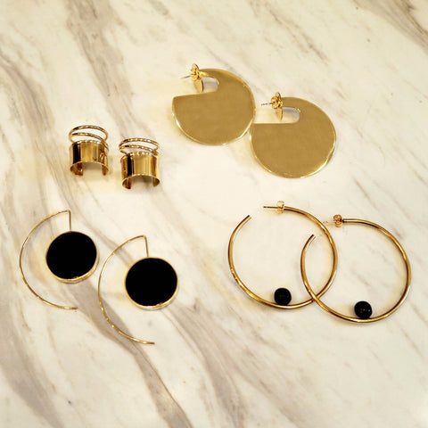 Accompany Exclusive Soko Hoop & Ball Earring. Polished brass hoop earring with hand carved horn ball detail. Add a touch of bohemian glam to your look with these intricately designed hoop earrings. Post fastening for pierced ears. Handcrafted in Kenya using traditional artisan techniques. 2 inch diameter hoop. Color gold black. 100% recycled brass, hand carved bone. One size.