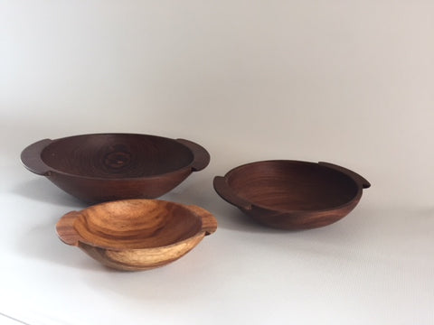Nesting Bowl Set by Itza Wood. Handcrafted in Guatemala. Hand carved by local artisans in Petén Guatemala, these bowls celebrate the natural color, texture and character of sustainably harvested Jobillo, Granadillo, and Manchiche woods native to the Guatemalan jungle. Color brown. 100% sustainably harvested wood.