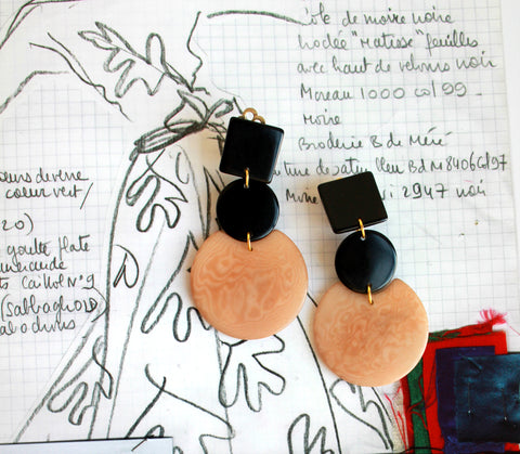"Frica Earrings by Shicato SPring 2018. These brown and black statement earrings are individually handcrafted in Ecuador. They are light and hollow which makes them fragile, due to their nature. Please handle delicately and lovingly. Material: Tagua Nut, Weight 10gr approx, lightweight and hand cut. Measurements 2.16"" H x 1.19"" W"