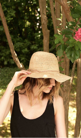 "Mar y Sol Mika Hat in Natural. Medium brim fedora crocheted raffia sun hat with adjustable wire brim. Handmade in Madagascar. 4"" brim, 5"" crown, 23"" circumference. Color nude. Crafted using organically tanned leathers and responsibly sourced raw materials. 100% crocheted raffia with organic leather trim and interior cotton sweatband. One Size Fits Most."