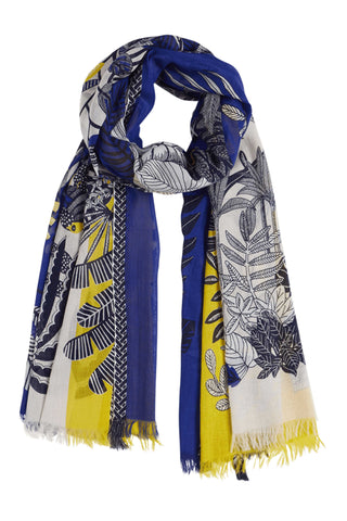 Inouitoosh Spring 2018 Jungle Scarf in Yellow Blue. Lightweight color block printed scarf featuring graphic tropical pattern. Frayed edges. Woven borders. Mat weave. Measures 40 inches by 75 inches. Color Yellow Blue. 100% cotton. One size.