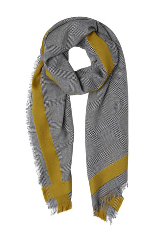 Inouitoosh Fall 2018 Nicol Scarf in Saffron. Wool houndstooth weave scarf featuring woven checks and bold, contrast border stripes. Both masculine and feminine at once, this scarf is a fall classic. 28 inches by 75 inches. Color grey yellow. 100% wool. One size.