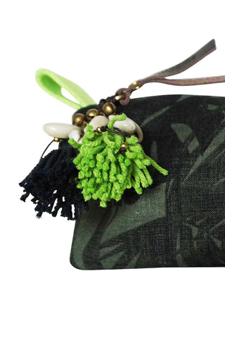Aloha Neon Small Cosmetic Case in Neon Green by JADEtribe. Cotton palm lime green pattern textile with neon zip cosmetic bag with puka tassel and nylon lining. Available exclusively at Accompany! Perfect for pencils, cosmetics and other accessories. Measurements Approximately L10 x H4 x W3 inches