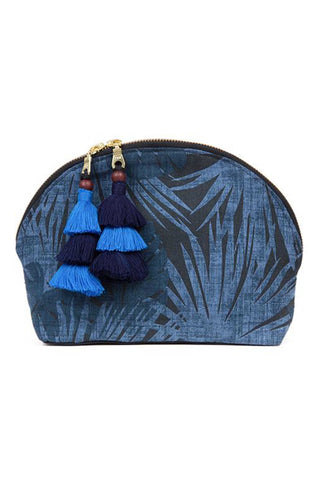 "The Aloha Indigo Tassel Cosmetic Pouch in Indigo and Blue by JADETribe is perfect for summer travels! Palm pattern cotton cosmetic bag with handmade multi tassels, double zipper and nylon lining. Measurements 10"" L x 7"" H x 3"" W."