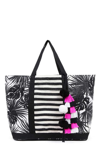 Aloha St. Jean tote by Jadetribe in Pink and Black. The new Palm pattern and nautical stripe combination creates the perfect transitional beach bag. Comes with removable tassel pom and interior side pocket. MeasurementsL16 x H14 x W8 inches